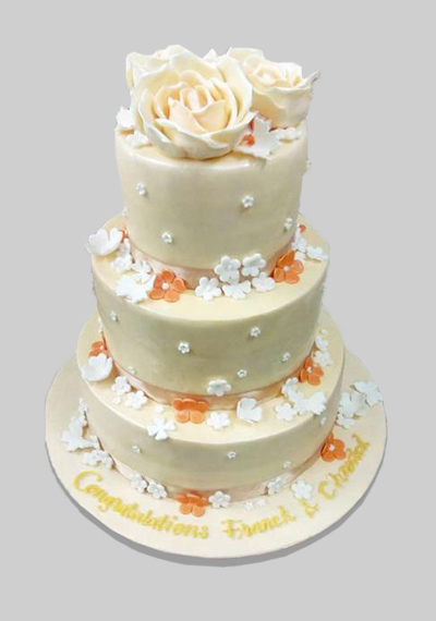 Floral Decor Off White Wedding Cake